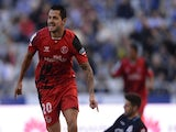 Sevilla's midfielder Vitolo celebrates after scoring a goal during the Spanish league football match RC Deportivo de la Coruna on March 7, 2015