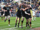Elliot Daly of Wasps celebrates with team mates after scoring a try during the Aviva Premiership match between Wasps and Saracens at The Ricoh Arena on March 8, 2015