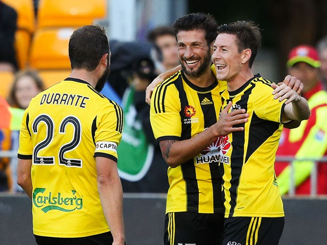 Andrew Durante and Vince Lia of the Phoenix congratulate teammate Nathan Burns on his goal during the round 20 A-League match between the Wellington Phoenix and Adelaide United at Hutt Recreation Ground on March 7, 2015