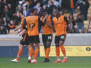 Benik Afobe of Wolves celebrates with team mates after scoring the opening goal of the game during the Sky Bet Championship match between Wolverhampton Wanderers and Watford at Molineux on March 7, 2015