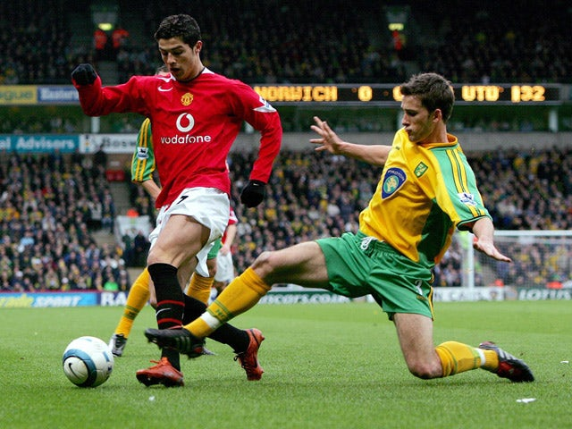 Norwich City's Adam Drury attempts to tackle Manchester United's Cristiano Ronaldo at the Carrow Road stadium 09 April 2005