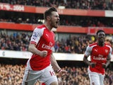 Arsenals Welsh midfielder Aaron Ramsey celebrates scoring 2-0 during the English Premier League football match between Arsenal and West Ham United at The Emirates Stadium in London on March 14, 2015