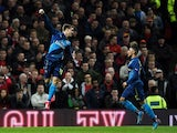 Nacho Monreal of Arsenal celebrates after scoring the opening goal with teammate Alex Oxlade-Chamberlain of Arsenal during the FA Cup Quarter Final match between Manchester United and Arsenal at Old Trafford on March 9, 2015