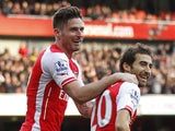 Arsenals French midfielder Mathieu Flamini celebrates scoring his goal with Arsenals French striker Olivier Giroud during the English Premier League football match between Arsenal and West Ham United at The Emirates Stadium in London on March 14, 2015