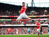 Olivier Giroud of Arsenal celebrates scoring the opening goal during the Barclays Premier League match between Arsenal and West Ham United at Emirates Stadium on March 14, 2015