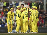 Mitchell Starc celebrates with Australia teammates on the way to defeating Scotland in the World Cup on March 14, 2015