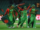 Bangladesh celebrate after winning the 2015 ICC Cricket World Cup match between England and Bangladesh at Adelaide Oval on March 9, 2015