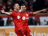 Leverkusen's forward Karim Bellarabi and Leverkusen's Swiss forward Josip Drmic celebrate after a goal during the German first division Bundesliga football match Bayer 04 Leverkusen v VfB Stuttgart in Leverkusen, Germany, on March 13, 2015