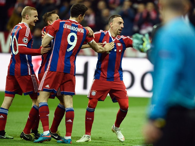 Bayern Munich's French midfielder Franck Ribery celebrates scoring the 3-0 goal with his team-mates during the UEFA Champions League second-leg, Round of 16 football match FC Bayern Munich vs Shakhtar Donetsk in Munich, southern Germany, on March 11, 2015
