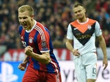 Bayern Munich's defender Holger Badstuber celebrates scoring the 5-0 goal during the UEFA Champions League second-leg, Round of 16 football match FC Bayern Munich vs Shakhtar Donetsk in Munich, southern Germany, on March 11, 2015