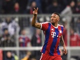 Bayern Munich's defender Jerome Boateng celebrates scoring the 2-0 goal during the UEFA Champions League second-leg, Round of 16 football match FC Bayern Munich vs Shakhtar Donetsk in Munich, southern Germany, on March 11, 2015