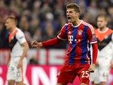 Bayern Munich's midfielder Thomas Muller celebrates after scoring a penalty during the UEFA Champions League second-leg round of 16 football match FC Bayern Munich vs Shaktar Donetsk in Munich, southern Germany, on March 11, 2015