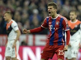 Bayern Munich's midfielder Thomas Muller celebrates after scoring a penalty during the UEFA Champions League second-leg round of 16 football match FC Bayern Munich vs Shaktar Donetsk in Munich, southern Germany, on March 11, 2015