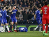 Dutch referee Bjorn Kuipers gives the red card to Paris Saint-Germain's Swedish forward Zlatan Ibrahimovic following a clash with Chelsea's Brazilian midfielder Oscar (Below L) during the UEFA Champions League round of 16 second leg football match between