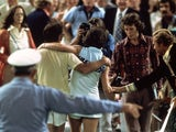 Bobby Riggs of the USA comes off court defeated by Billie Jean-King of the USA after a Battle of the Sexes Challenge Match held at the Astrodome, in Houston, Texas