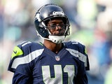 Byron Maxwell #41 of the Seattle Seahawks looks on against the Green Bay Packers during the 2015 NFC Championship game at CenturyLink Field on January 18, 2015