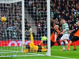 Kris Commons of Celtic scores the opening goal during the Scottish League Cup Final between Dundee United and Celtic at Hampden Park on March 15, 2015