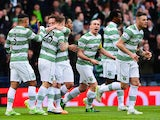 Kris Commons of Celtic celebrates scoring the opening goal with Leigh Griffiths and Emilio Izaguirre during the Scottish League Cup Final between Dundee United and Celtic at Hampden Park on March 15, 2015
