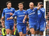 Chelsea's Brazilian player Alex celebrates scoring his opening goal with German midfielder Michael Ballack, Serbian defender Branislav Ivanovic, and Ivorian striker Didier Drogba during the English Premier League football match between Chelsea and West Ha