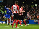 Diego Costa of Chelsea heads in the opening goal during the Barclays Premier League match between Chelsea and Southampton at Stamford Bridge on March 15, 2015