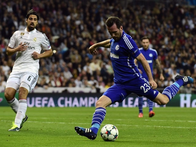 Schalke's Austrian defender Christian Fuchs (R) kicks and scores during the UEFA Champions League round of 16 second leg football match against Real Madrid  on March 10, 2015