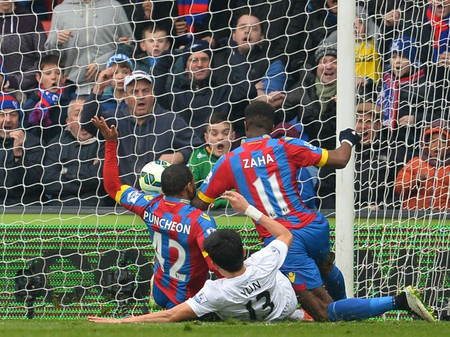Crystal Palace's Ivorian-born English striker Wilfried Zaha falls as he aims to score the opening goal during the English Premier League football match between Crystal Palace and Queens Park Rangers at Selhurst Park in London on March 14, 2015