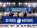 The England team celebrate with the Calcutta Cup during the RBS Six Nations match between England and Scotland at Twickenham Stadium on March 14, 201
