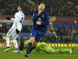 Everton's Scottish striker Steven Naismith celebrates after scoring his team's first goal during the UEFA Europa League last-16 first leg football match between Everton FC and Dynamo Kiev at the Goodison Park in Liverpool on March 12, 2015