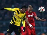 FC Koln's midfielder Kevin Vogt and Dortmund's Gabonese striker Pierre-Emerick Aubameyang vie for the ball during the German first division Bundesliga football match Borussia Dortmund v 1 FC Koln in Dortmund, Germany, on March 14, 2015.