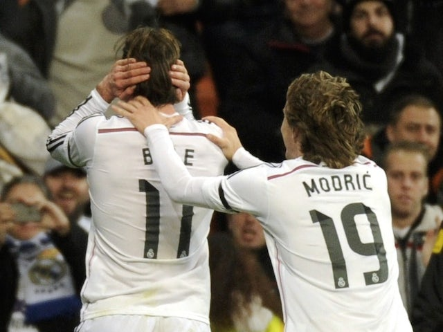 Real Madrid's Welsh forward Gareth Bale (L) celebrates a goal with teammate Real Madrid's Croatian midfielder Luka Modric (2nd L) during the Spanish league football match on March 15, 2015