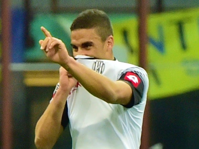 Cesena's forward from France Gregoire Defrel (L) celebrates after scoring a goal during the Serie A football match Inter Milan vs Cesena at San Siro Stadium in Milan on March 15, 2015