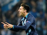 Porto's Mexican midfielder Hector Herrera celebrates after scoring a goal during the UEFA Champions League round of 16 second leg football match  against Basel on March 10, 2015