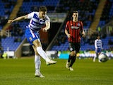 Jamie Mackie of Reading scoresl during the Sky Bet Championship match between Reading and Brighton & Hove Albion at Madejski Stadium on March 10, 2015