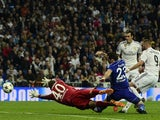 Real Madrid's French forward Karim Benzema kicks and scores against Schalke during the Champions League match on March 10, 2015