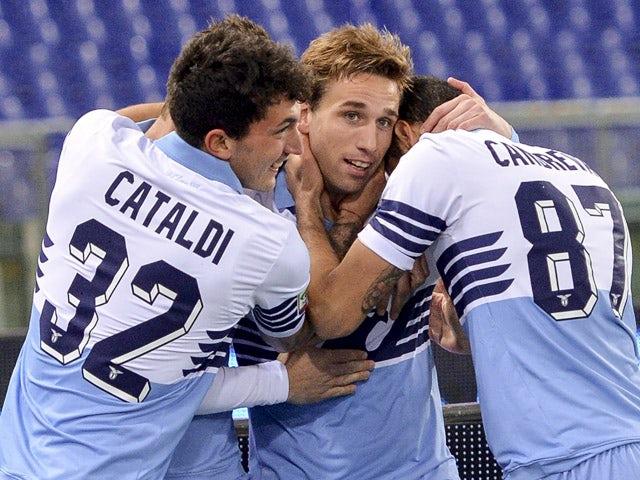 Lazio's Argentinian midfielder Lucas Biglia celebrates with teammates after scoring against Fiorentina on March 9, 2015