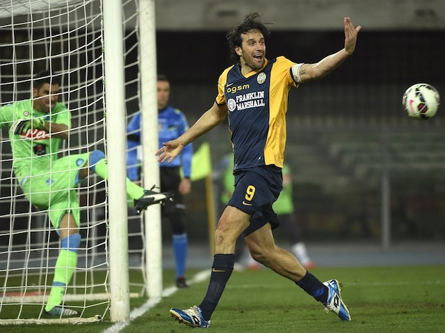 Verona's forward Luca Toni celebrates after scoring a second goal during the Italian Serie A foot ball match Hellas Verona vs Napoli on March 15, 2015