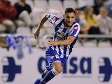 Lucas Perez of Real Club Deportivo in action during the Teresa Herrera Trophy match between Real Sporting de Gijon and Real Club Deportivo at estadio Municipal de Riazar on August 10, 2014