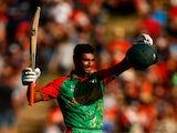 Mahmudullah of Bangladesh celebrates his century during the 2015 ICC Cricket World Cup match between Bangladesh and New Zealand at Seddon Park on March 13, 2015