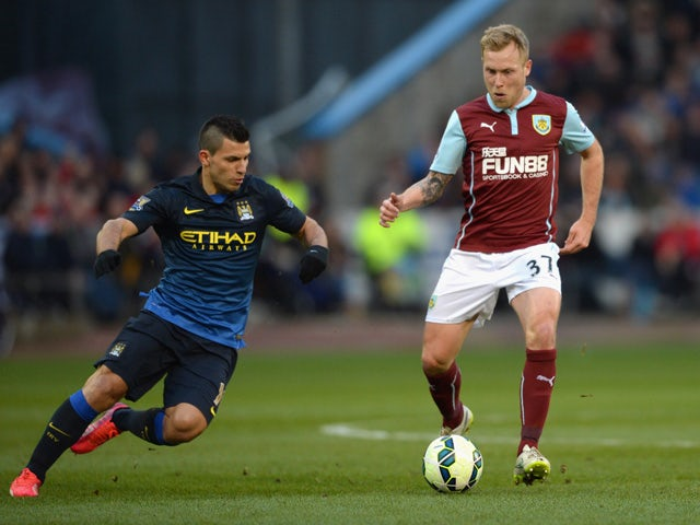 Sergio Aguero of Manchester City marshalls Scott Arfield of Burnley during the Barclays Premier League match between Burnley and Manchester City at Turf Moor on March 14, 2015