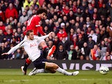 Marouane Fellaini of Manchester United shoots past Eric Dier of Spurs to score the opening goal during the Barclays Premier League match between Manchester United and Tottenham Hotspur at Old Trafford on March 15, 2015