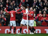 Marouane Fellaini of Manchester United is congratulated by teammates Juan Mata of Manchester United and Wayne Rooney of Manchester United after scoring the opening goal during the Barclays Premier League match between Manchester United and Tottenham Hotsp