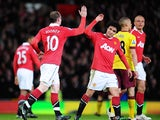 Wayne Rooney of Manchester United celebrates scoring his side's second gaol with teammate Rafael Da Silva during the FA Cup sponsored by E.On Sixth Round match between Manchester United and Arsenal at Old Trafford on March 12, 2011