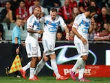 Archie Thompson of Melbourne Victory celebrates with Besart Berisha after scoring a goal during the round 21 A-League match between the Western Sydney Wanderers and Melbourne Victory at Pirtek Stadium on March 13, 2015