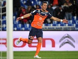 Montpellier's forward Lucas Barrios celebrates after scoring a goal during the French L1 football match between Montpellier and Reims on March 14, 2015