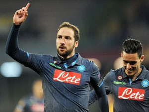 Gonzalo Higuain of Napoli celebrates after scoring goal 3-1 during the UEFA Europa League Round of 16 football match between SSC Napoli and FC Dinamo Moskva at the San Paolo Stadium on March 12, 2015