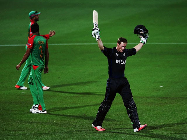 Martin Guptill of New Zealand celebrates after scoring a century during the 2015 ICC Cricket World Cup match between Bangladesh and New Zealand at Seddon Park on March 13, 2015