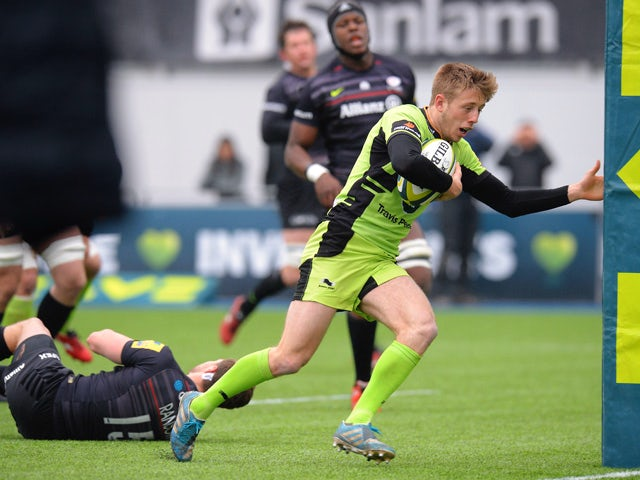 Sam Olver of Northampton Saints runs in to score a try during the LV= Cup Semi Final match between Saracens and Northampton Saints at Allianz Park on March 14, 2015