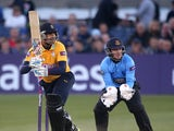 Owais Shah of Hampshire hits out while Ben Brown of Sussex looks on during the Natwest T20 Blast match between Sussex Sharks and Hampshire at The BrightonandHoveJobs.com County Ground on May 23, 2014