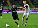Inter Milan's forward from Argentina Rodrigo Palacio fights for the ball with Cesena's midfielder from Iceland Hordur Bjorgvin Magnusson (R) during the Serie A football match on March 15, 2015