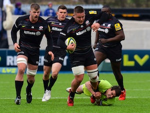 Richard Barrington of Saracens is tackled by Lee Dickson of Northampton Saints during the LV= Cup Semi Final match between Saracens and Northampton Saints at Allianz Park on March 14, 2015
